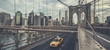 Famous Brooklyn Bridge with cab