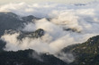 Aerial view on mountaintops covered with clouds during sunrise - 199197941