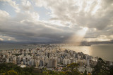 Panoramic view of the city's downtown. Light rays shining over the buildings and the bay. Rain clouds at distance, colorful clouds. Florianópolis, Santa Catarina / Brazil - 199202728
