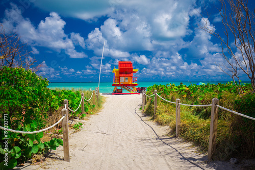 Miami Beach in South Beach with new lifeguard tower and coastline with colorful cloud and blue sky. Florida. USA.  - 199203771