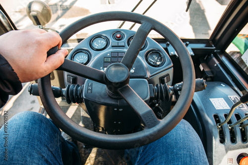 Fotobehang Trekker 3789984 Driver in modern combine or tractor cabin, view from driver eye position