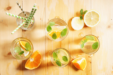 citrus fruit water with mint leaves