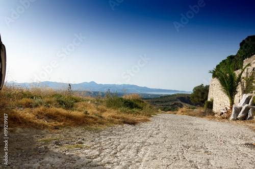 Fotobehang Blauwe hemel Agricultural field in Crete, Greece