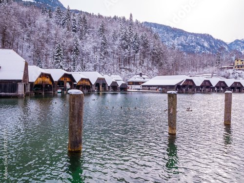 Fotobehang Lavendel Beautiful view of traditional wooden boat port house at the shores of famous Lake Obersee Königssee in scenic Nationalpark Berchtesgaden Land on winter season snow, Bavaria, Germany