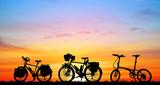 silhouette vintage bike on sunrise