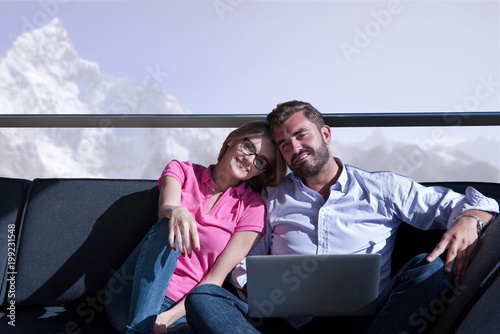 couple relaxing at  home using laptop computers Poster