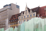 Colorful Wroclaw old town, beautifully renovated old tenement houses,  fountain in the foreground