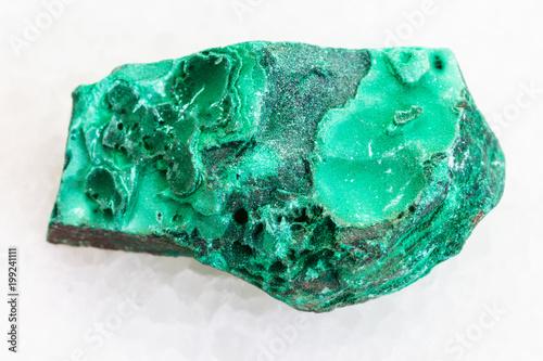rough green malachite stone on white marble