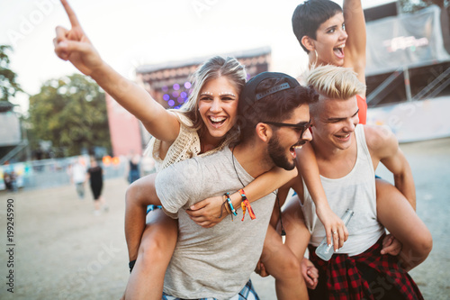 Group of friends having fun time at music festival - 199245990