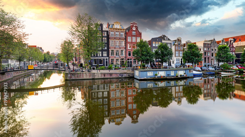 Foto op Aluminium Amsterdam Traditional Dutch old houses on canals in Amsterdam, Netherland.