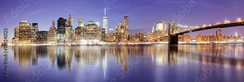 New York panorama with Brooklyn bridge at night, USA