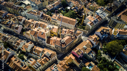 Aerial view from drone on small town located in mountains near by Lisbon - Sintra. Red rooftops, streets, town infrastructure is seen on image. Portugal. Top view.