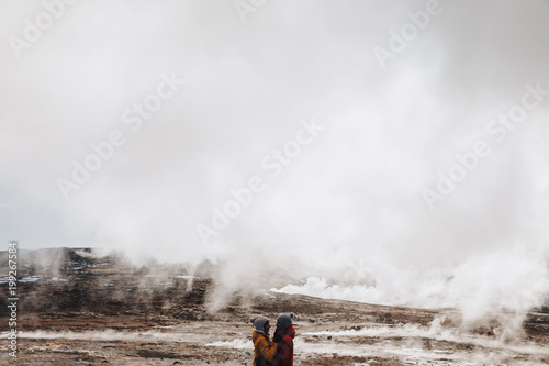 beautiful young couple embracing near majestic hot springs in iceland, reykjanes, Gunnuhver Hot Springs