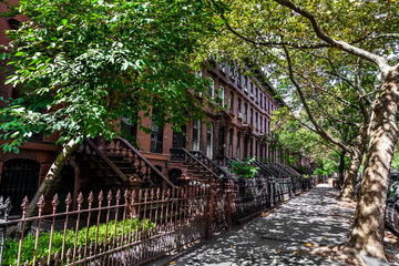 Brownstone Homes along residential Neighbourhood sidewalk in Brooklyn New York