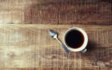 Mug of Black Coffee on rustic wooden table; seen from above - 199285398