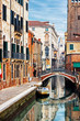Ponte San Barnaba bridge and old street in Venice, Italy