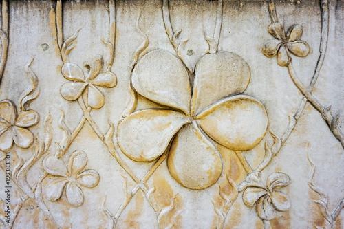 Fotobehang Plumeria Plumeria flower carving in stone