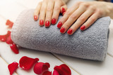 woman fingernails with red nail polish on towel roll perfect manicure - 199307989