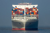 front view of a cargo shipping sea container ship