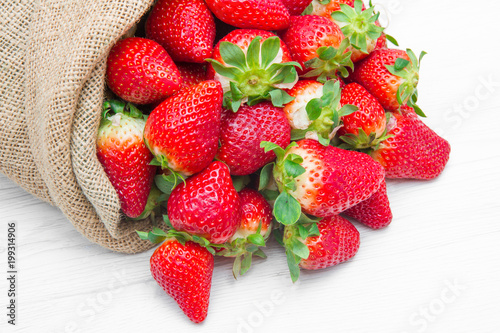 canvas sack full of red strawberry