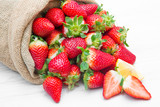 canvas sack full of  red strawberry - 199315380