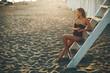 Pretty yung woman sitting on the beach