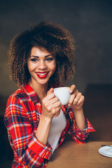 Young woman at cafe drinking coffee