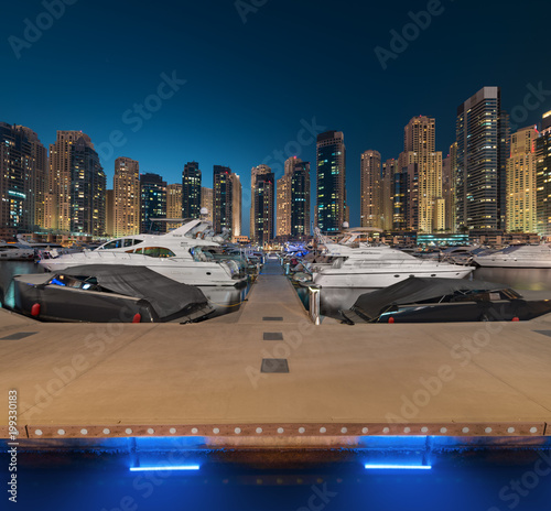 Foto op Plexiglas Dubai Dubai Marina Yacht Club in a magical blue Sunset