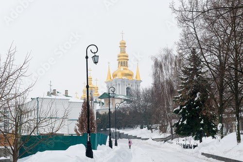 Foto op Plexiglas Kiev Kiev, Ukraine. Pechersk Lavra Monastery. A snow-covered avenue leading to distant caves.