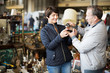 Mature couple buying antique things at the fleamarket