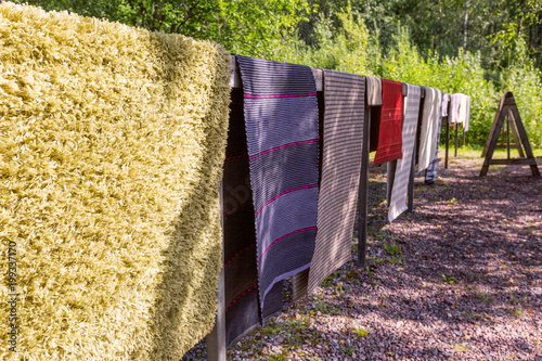 Traditional summer rug washing in Finland, carpet drying