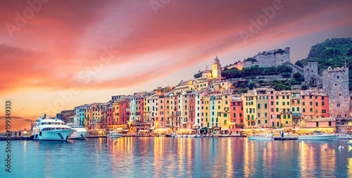 Mystic landscape of the harbor with colorful houses in the boats in Porto Venero, Italy, Liguria in the evening in the light of lanterns at sunset