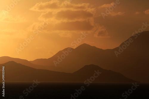 In de dag Ochtendgloren golden sunlight over mountains and sea, St. Croix, U.S. Virgin Islands,Lesser Antilles, Caribbean
