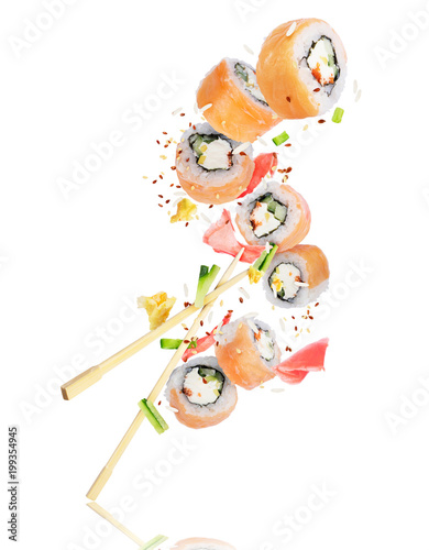 In de dag Sushi bar Pieces of sushi with chopsticks frozen in the air, isolated on white background