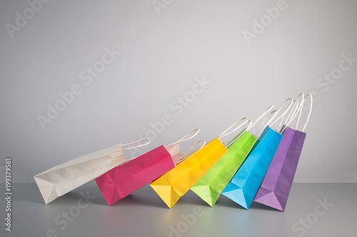 some colorful paper present bag