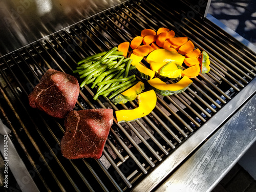 barbecue preparation on gas stove, before cooking. Barbecue consists of meat, green beans, pumpkins and carrots