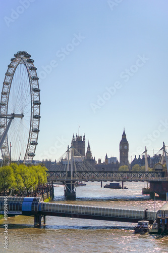Fotobehang Londen London, United Kingdom. April 9, 2017. London Landmark of The Eye with Many Tourist on The Sidewalk, The Westminster Bridge and The Festival Pier, Lambeth, London