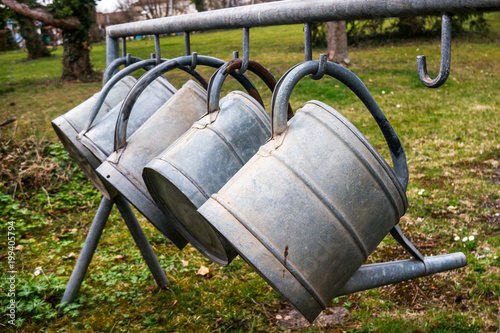 cemetry watering cans