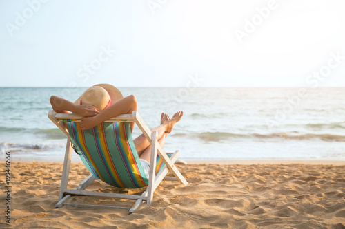 Leinwanddruck Bild Woman on beach in summer