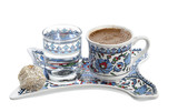 Traditional Turkish coffee served with Turkish delight isolated on white background.