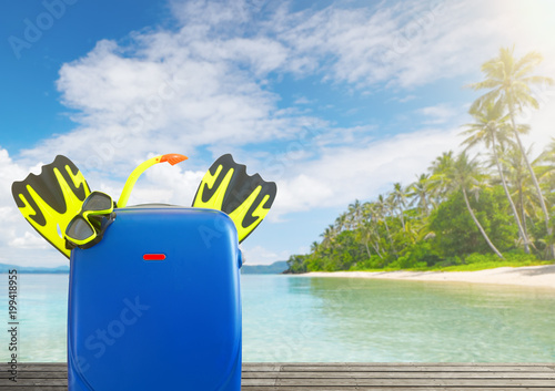 Concept of summer travelling with colorful suitcase and accessories. - 199418955