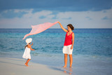 Mother and little daughter walking on the beach - 199430175