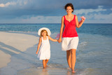 Mother and little daughter walking on the beach - 199430191