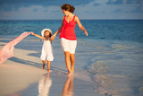 Mother and little daughter walking on the beach - 199430198