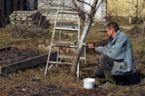 Spring protection of fruit trees in the garden.Whitewashing of trees in spring - 199431158