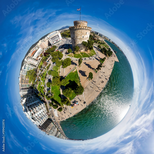 Foto Murales Little planet panorama of the famous white tower in the city of Thessaloniki in northern Greece