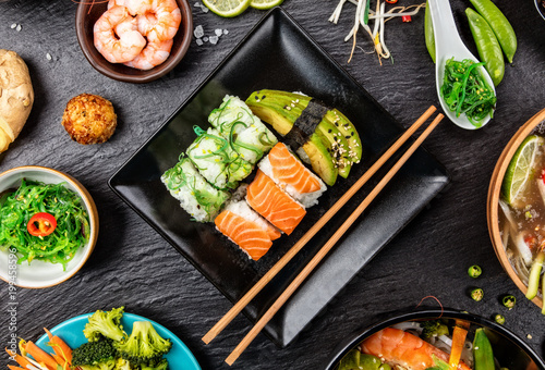 Asian Sushi variation with many kinds of meals. - 199458596