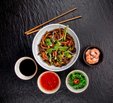 Asian udon noodles with spicy soy sauce and chicken pieces, top view - 199458743