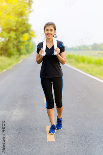 Beautiful girl running on road, Healthy fitness woman training