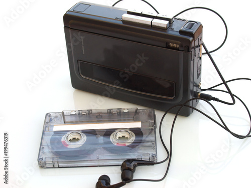 vintage music cassette tape and walkman recorder over white white background - 199476319